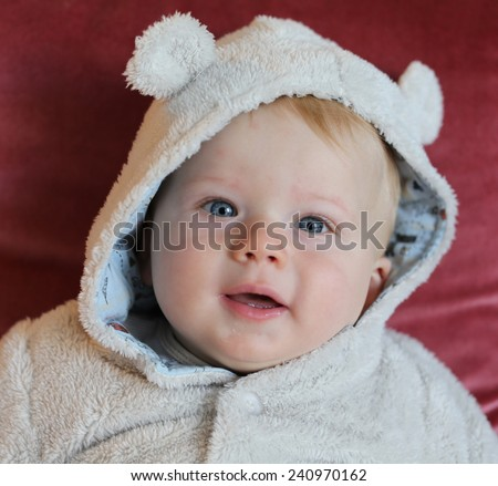 Portrait of a smiling baby boy with blue eyes. - stock photo
