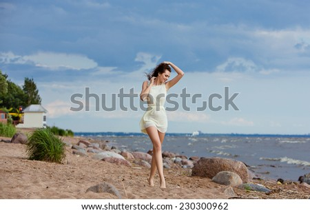Portrait of a smiling barefoot girl who goes to the beach