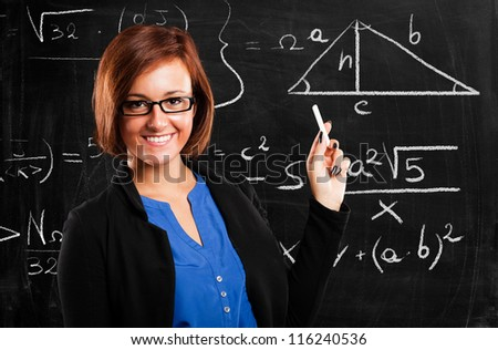 Portrait of a smiling beautiful math teacher - stock photo