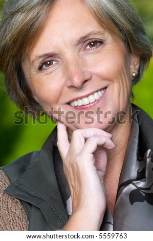 Portrait of a smiling beautiful mature woman - stock photo
