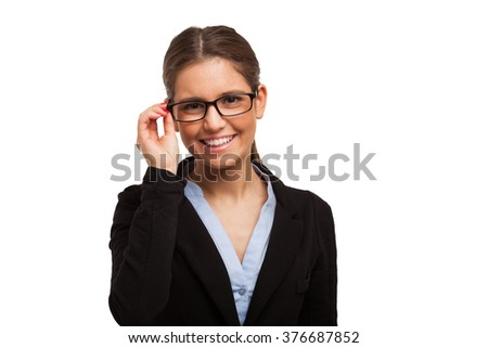 Portrait of a smiling beautiful woman holding her eyeglasses