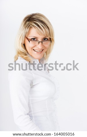 Portrait of a smiling blonde girl with glasses - stock photo