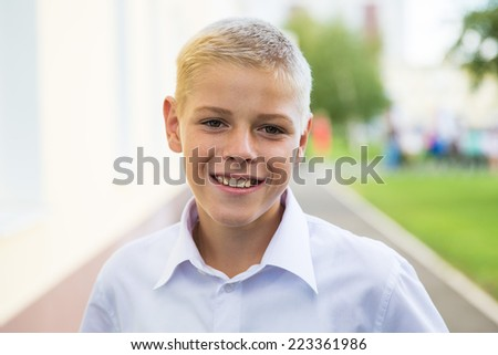 Portrait of a smiling boy in a white shirt. Schoolboy 1 September. - stock photo