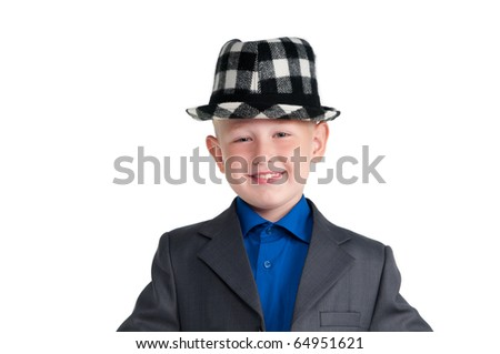 Portrait of a smiling boy in suit with black hat