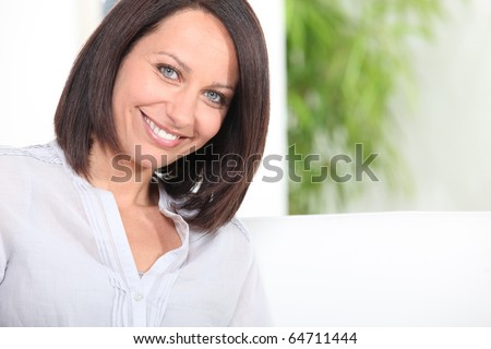 Portrait of a smiling brown-haired woman - stock photo