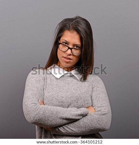 Portrait of a smiling business woman against gray background - stock photo