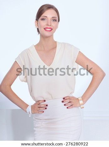 Portrait of a smiling business woman standing . - stock photo