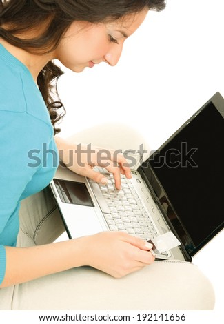 Portrait of a smiling business woman with a laptop
