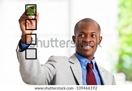 Portrait of a smiling businessman voting for yes - stock photo