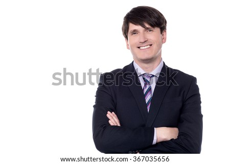 Portrait of a smiling businessman with folded arms