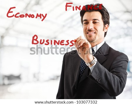 Portrait of a smiling businessman writing on the screen