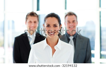 Portrait of a smiling businesswoman with her team
