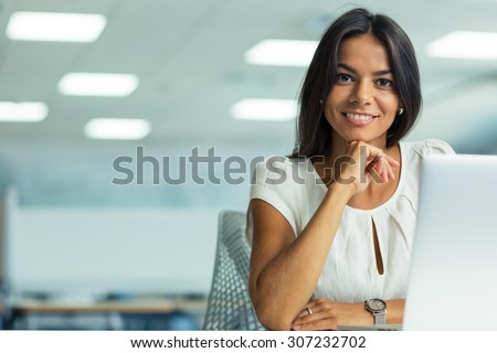 Portrait of a smiling businesswoman working in office  - stock photo