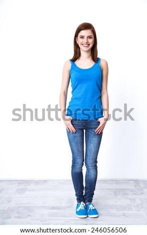 Portrait of a smiling casual woman looking at the camera - stock photo
