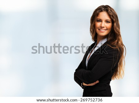 Portrait of a smiling cheerful business woman. Bright background - stock photo
