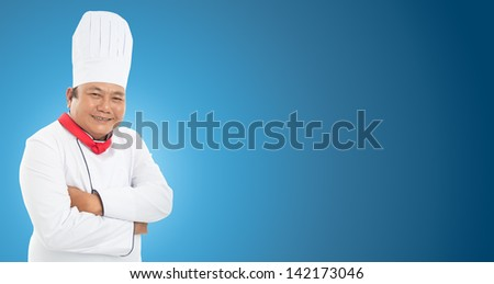 Portrait of a smiling chef cook posing isolated on blue - stock photo