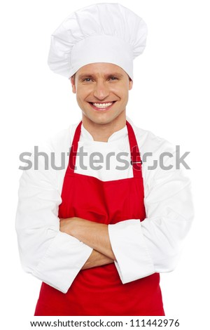 Portrait of a smiling chef with his arms crossed isolated against white background - stock photo