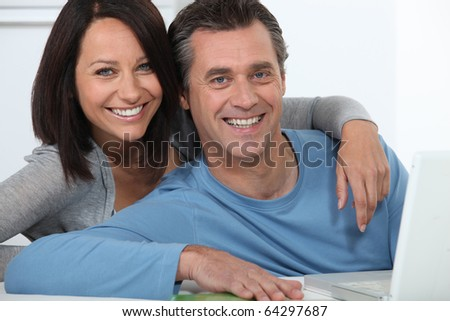 Portrait of a smiling couple - stock photo