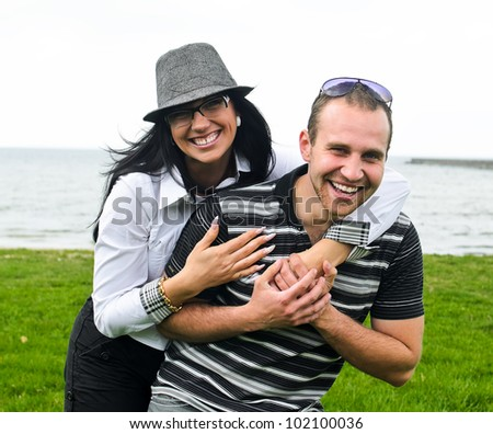 Portrait of a smiling couple by the sea - stock photo