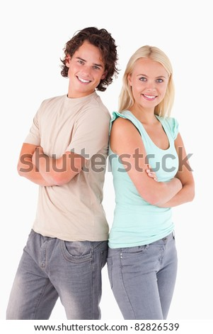 Portrait of a smiling couple looking into the camera in a studio