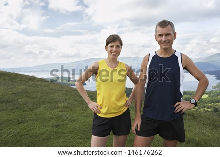 Portrait of a smiling couple standing on country landscape