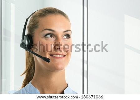 Portrait of a smiling customer representative - stock photo