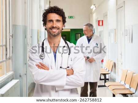 Portrait of a smiling doctor in an hospital - stock photo