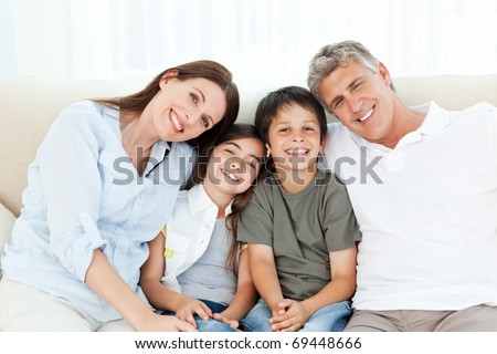 Portrait of a smiling family at home - stock photo