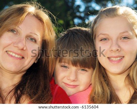 Portrait of a smiling family of mother and her children - stock photo