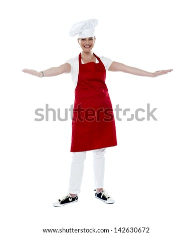 Portrait of a smiling female chef, arms outstretched