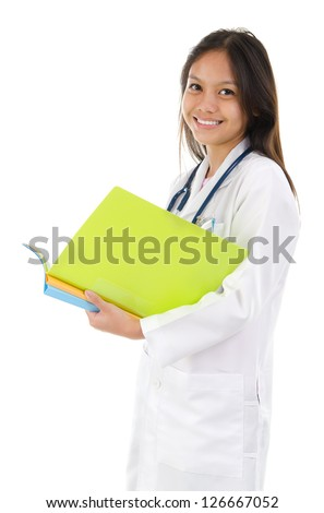 Portrait of a smiling female medical student with confident smile standing isolated on white background, model is a southeast asian woman. - stock photo