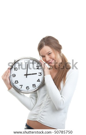 Portrait of a smiling girl holding clock over white background