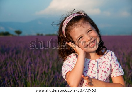 Portrait of a smiling girl in a lavender field