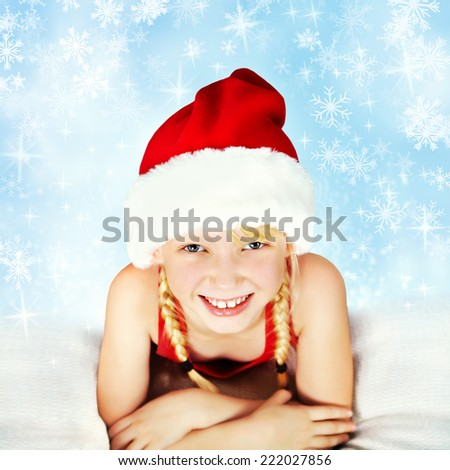 portrait of a smiling girl in a Santa hat. Christmas child - stock photo