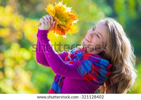 Portrait of a smiling girl in the autumn park