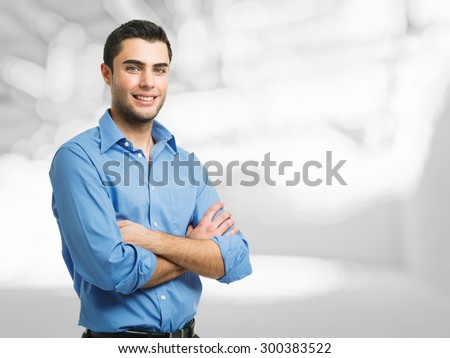 Portrait of a smiling handsome man - stock photo