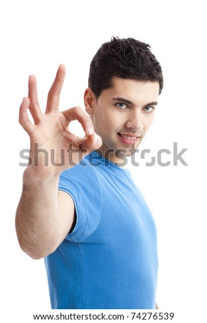 Portrait of a smiling handsome young man gesturing ok sign over a  white background - stock photo