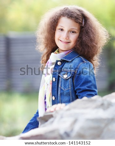 Portrait of a smiling happy little girl outdoor