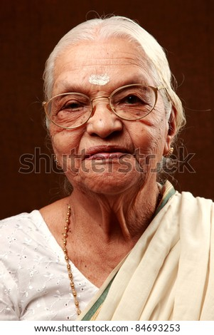 Portrait of a smiling Indian senior woman - stock photo