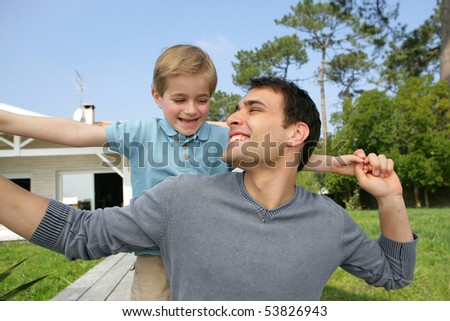 Portrait of a smiling little boy with a man - stock photo