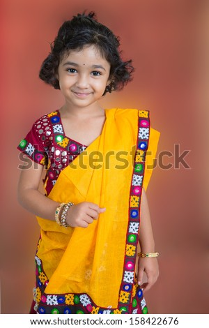Portrait of a Smiling Little Girl in Traditional Indian Costume - stock photo
