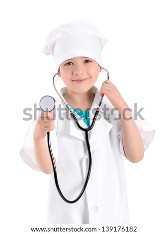 Portrait of a smiling little girl wearing as a nurse on white uniform and holding a stethoscope in hand. Isolated on white background. - stock photo