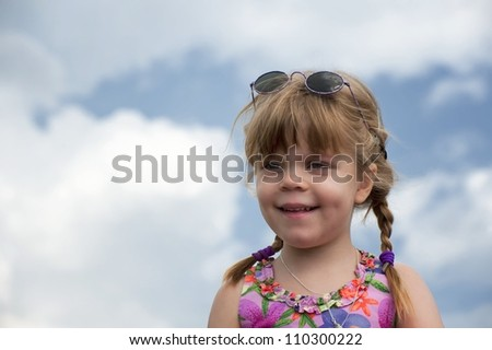 Portrait of a smiling little girl with braids - stock photo