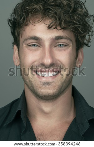 Portrait of a smiling man, color-processed image - stock photo