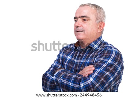 Portrait of a smiling man with arms folded against white background - stock photo