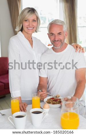 Portrait of a smiling mature couple having breakfast at home