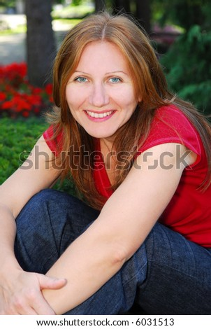 Portrait of a smiling mature woman outside - stock photo
