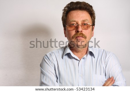 Portrait of a Smiling Middle aged businessman - stock photo