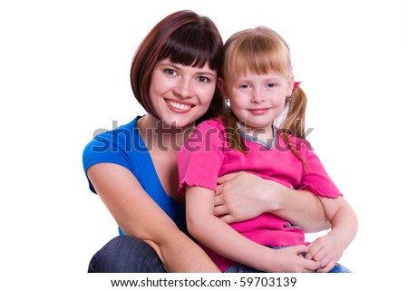 Portrait of a smiling mother and daughter. Woman and girl. - stock photo