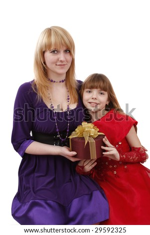 Portrait of a smiling mother and teenage daughter. Woman and girl are holding the present. Mother and daughter want to give dad the gift. - stock photo